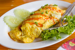 Omelete with sausage. On white plate royalty free stock photos