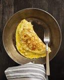 Omelett i en stekpanna Royaltyfria Foton