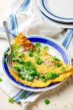 Omelett med gröna ärtor, parmesan och mintkaramellen Fotografering för Bildbyråer