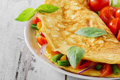 Omelett med grönsaker Fotografering för Bildbyråer