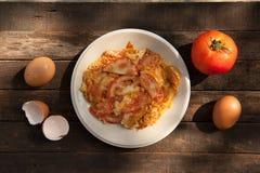 Omelett med tomater Arkivfoto