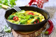 Omelett med tomater och broccoli Royaltyfri Fotografi