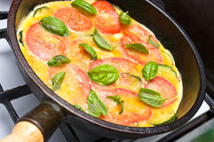 Omelette. With tomato, courgette and basil royalty free stock photo