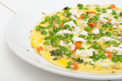 Omelette. Egg Omelette With Tomatoes, Peas and Feta Cheese Royalty Free Stock Photos