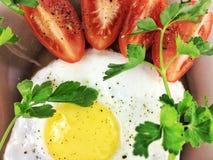 Omelette. Appetizing fried eggs for breakfast Stock Photos