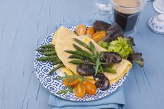 Omelette with asparagus and mushrooms champignons for breakfast. Fresh and healthy food. Free space for text. Fried egg stock photo