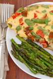 Omelette and asparagus Stock Images