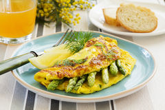 Omelette with asparagus. Stock Photography