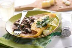 Omelette avec des champignons de couche Images libres de droits