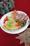 Omelette avec du jambon et des champignons de couche Photo stock