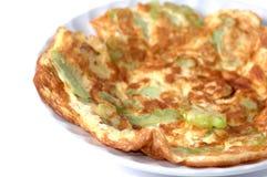 Omelette avec le melo amer Photographie stock