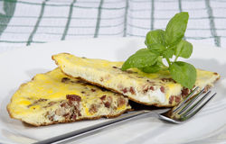 Omelette with bacon and basil Stock Photography