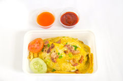 Omelette and bacon in white plastic box on white background Royalty Free Stock Photos