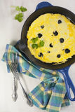 Omelette with black truffle and herbs Stock Photo