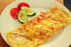 Omelette for breakfast on plate Stock Image