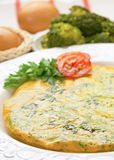 Omelette with broccoli Stock Photos