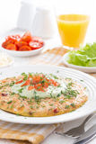 Omelette with carrot and green yogurt sauce for breakfast Royalty Free Stock Photo