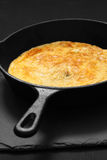 Omelette in a cast iron frying pan Stock Photo