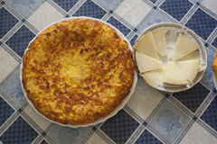 Omelette and cheese. View of a delicious omelette and some cheese slices ready for lunch royalty free stock photo