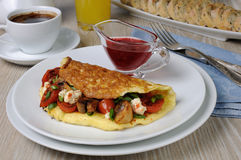 Omelette with cherry tomatoes, mushrooms , feta cheese Royalty Free Stock Images
