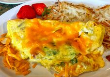 Omelette with chives and oregano, strawberries, cheese and  pota Stock Images