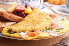 Omelette close up. Omelette with ham, bacon and vegetables close up Stock Photos