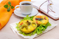 Omelette with colored pasta, mushrooms, vegetables and herbs. Cooked in the form of mafins and a cup of espresso. Breakfast Royalty Free Stock Photography
