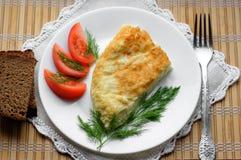 Omelette con i pomodori e l'aneto Fotografie Stock