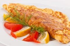 Omelette con le erbe, i pomodori ed il limone Immagini Stock Libere da Diritti