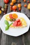 Omelette con le verdure ed il formaggio Frittata in una padella Fotografia Stock
