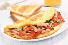 Omelette con le verdure ed il prosciutto Immagini Stock Libere da Diritti