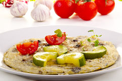 Omelette with courgette and tomato Royalty Free Stock Photography