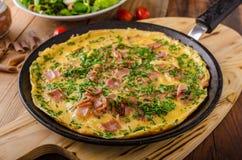Omelette de jambon et d'oeufs Images stock