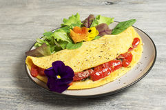Omelette del pomodoro e degli spinaci Fotografia Stock