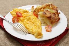 Omelette et pommes de terre Anna Images libres de droits