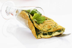 Omelette filled with spinach in glass Royalty Free Stock Photography