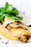 Omelette folded with mushrooms and fresh rocket Royalty Free Stock Photo