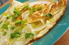 Omelette with fresh leek Stock Photos