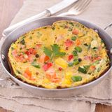 Omelette in frying pan Royalty Free Stock Photos