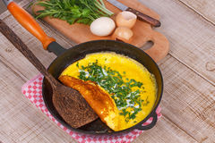 Omelette in a frying pan; Stock Images