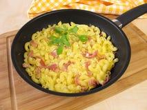 Omelette in frying pan Stock Image
