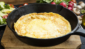 Omelette in a frying pan Royalty Free Stock Image