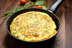 Omelette in frying pan Stock Photos