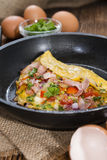 Omelette in a frypan (close-up shot) Royalty Free Stock Photography