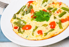 Omelette with green beans and cherry tomatoes stock photo
