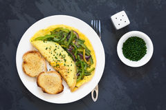 Omelette with Green Bell Pepper and Red Onion Stock Photos
