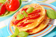 Omelette with ketchup Royalty Free Stock Photo