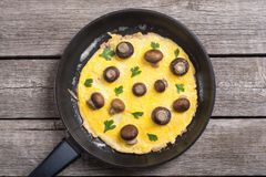 Omelette with mushroom. And parsley in pan . Frittata stock photos