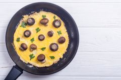 Omelette with mushroom. And parsley in pan . Frittata royalty free stock photo