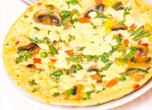 Omelette with mushrooms and vegetables Stock Images